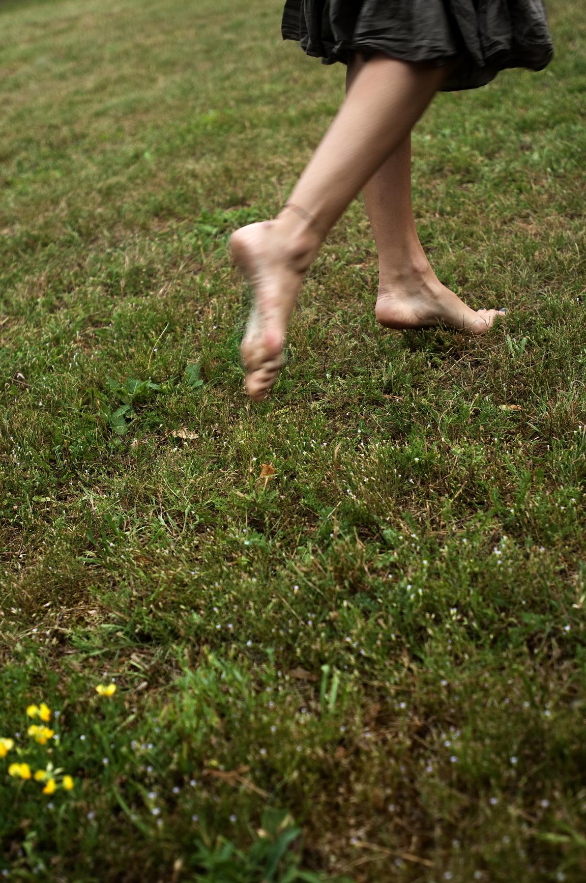 woman walking in grass - photo #27